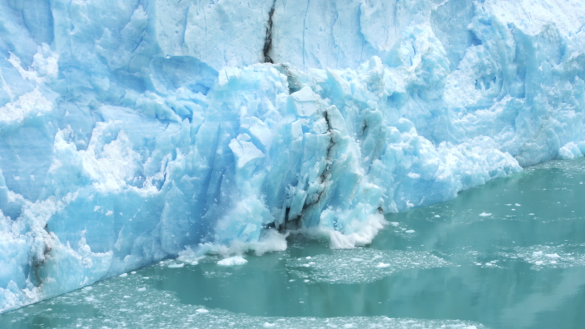 Glacier Ice Collapse Into Ocean Water, Close Up. Global Warming and Climate Change Concept | Shutterstock HD Video #1056645272