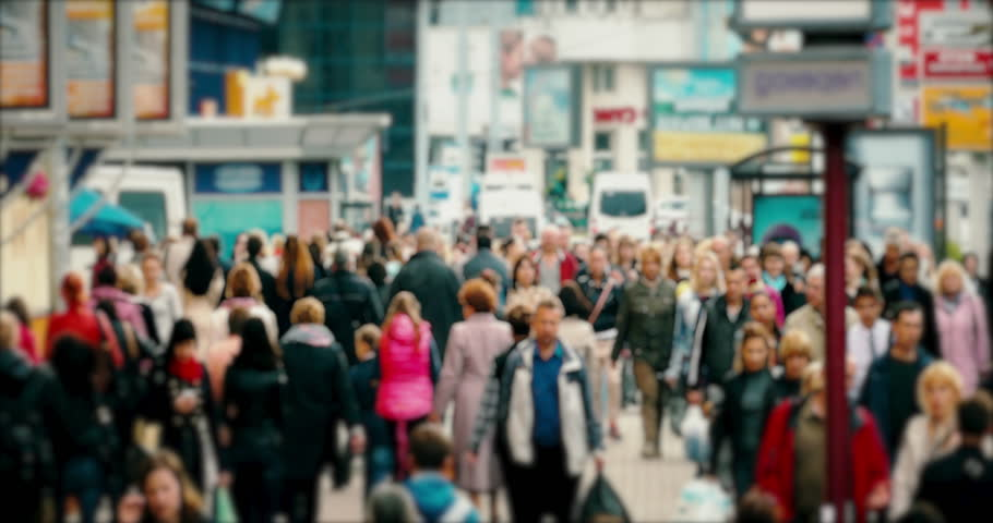 Crowd on a busy street. Anonymous crowd of people walk down a busy street with advertising, billboards, cars and public transport. | Shutterstock HD Video #10566566