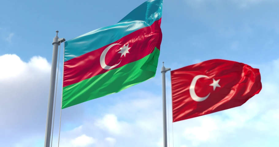 Azerbaijan and Turkey flag on flagpole. Azerbaijani and Turkish waving flag in wind. Сooperation, military exercises. Luma Track Mattes for background cutting.