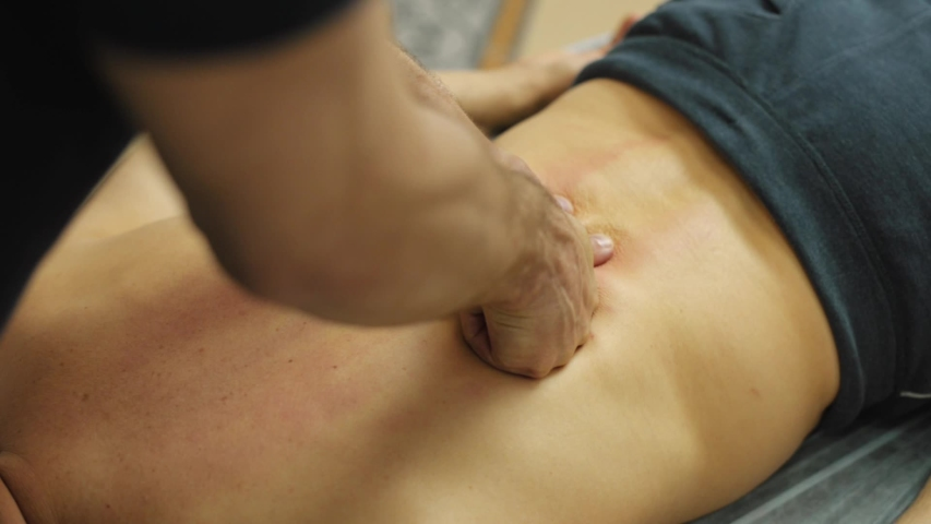 Footage of man making deep massage on back, be healthy. Royalty-Free Stock Footage #1056658124
