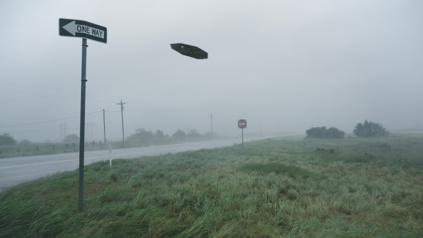 A Stop Sign Is Ripped From Its Pole During Hurricane Hanna #1056666689