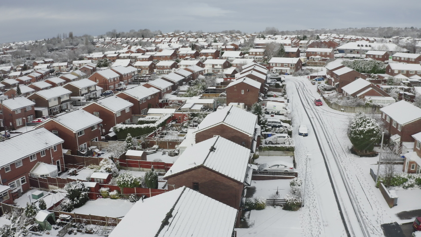 Aerial landscapes of the city of Stoke on Trent covered in snow after a sudden storm came in. Heavy snowfall and snowy blizzards covering the city in snow and ice, Longton, Fenton, West Midlands