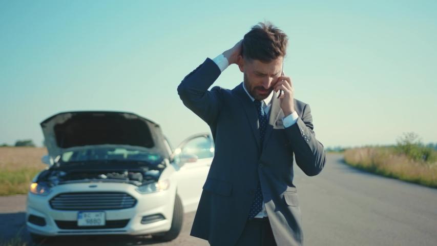 Sad businessman standing speak on phone near the broken car opened the hood road help repair stress problem emergency insurance auto slow motion