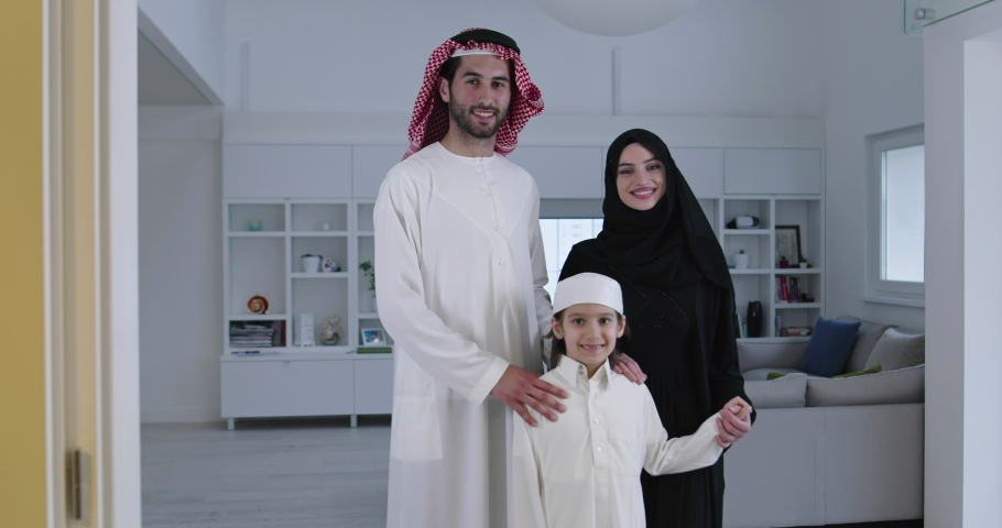 Muslim family with kid in modern home   Shutterstock HD Video #1056682175