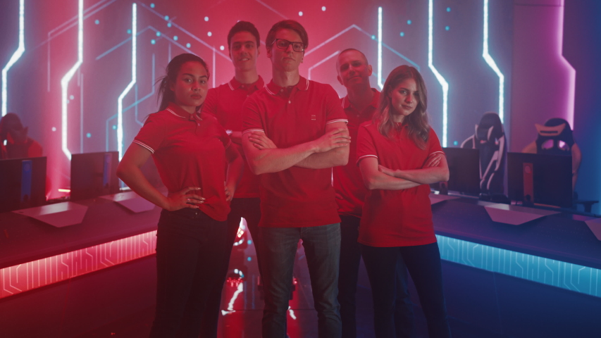 Diverse Gamers Esport Team Steps forward on a Stage Ready to Win Video Games Tournament, Posing at Tough Guys and Girls. Stylish Neon Championship Arena for Online Streaming of Cyber Games | Shutterstock HD Video #1056687194