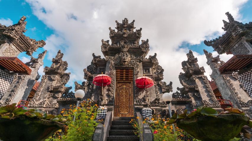 Gardian statue at entrance Bali temple / Bali Hindu temple / Bali, Indonesia Royalty-Free Stock Footage #1056692615