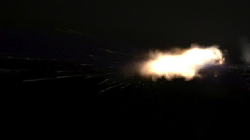 45 muzzle flashes continues fire montage in slow-motion. Dangerous shooting againgst black screen muzzle flashes in slow-motion.