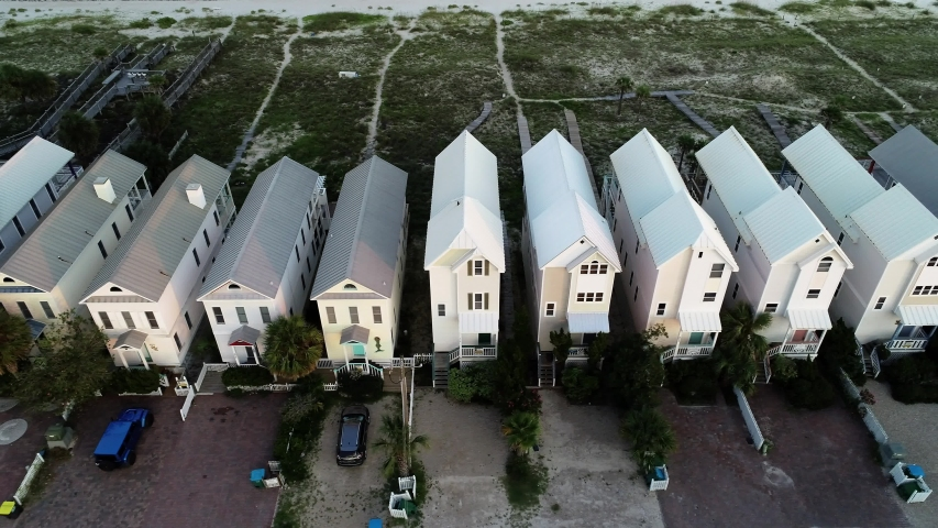 Houses Stand Along the Dunes on the Shores of the Gulf of Mexico in St. George Island, Florida.
