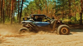 SLOW MOTION: Buggy car driving fast in cross country road. Fast rally auto is going with big clouds of dust. Speed riding of a racing off-road car in the forest road. Cinematic sport clip.