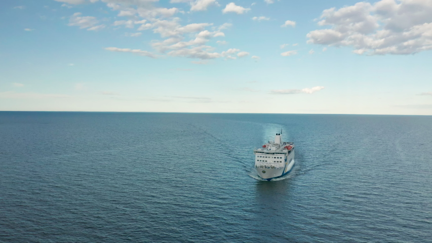 Cruise ship in the open ocean, aerial view  | Shutterstock HD Video #1056715349