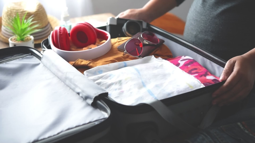 Tourists are packing luggage for travel.concept tourism planning and new normal travel | Shutterstock HD Video #1056725228
