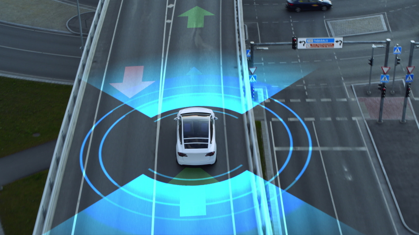 Following Aerial Drone View: Autonomous Self Driving Car Moving Through City Highway. Animated Visualization Concept: Sensor Scanning Road Ahead for Vehicles, Danger, Speed Limits. Day Urban Driveway