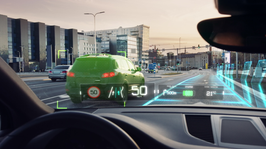 Futuristic Concept: Autonomous Self-Driving Car Moving Through City, Head-up Display HUD Showing Infographics: Speed, Distance, Navigation. Road Scanning. Point of View POV / First Person View FPV | Shutterstock HD Video #1056741536