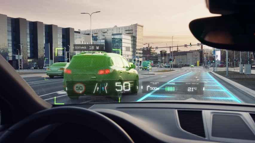 Futuristic Autonomous Self-Driving Car Moving Through City, Head-up Display HUD Showing Infographics: Speed, Distance, Navigation. Road Scanning. Driver Seat Point of View POV / First Person View FPV | Shutterstock HD Video #1056741542