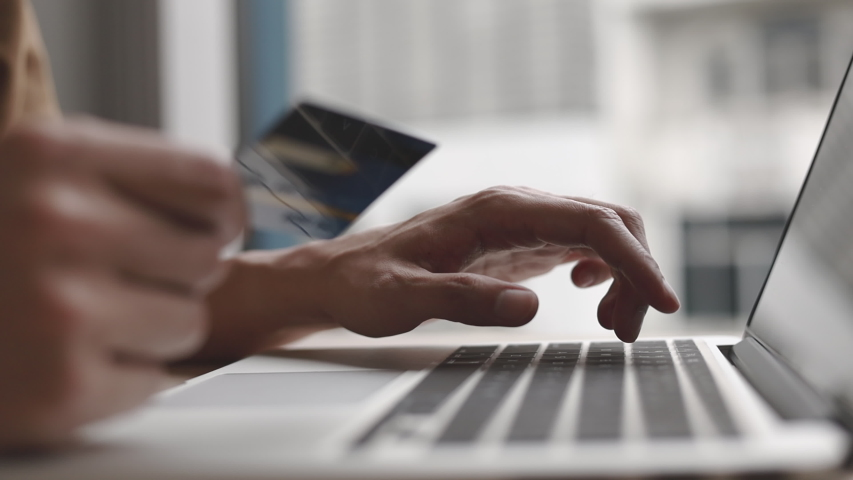 Close-up of the finger, Young man pressed the credit card code to pay online via the laptop at the desk in the room, Online purchases and use of credit cards concept. Royalty-Free Stock Footage #1056748877
