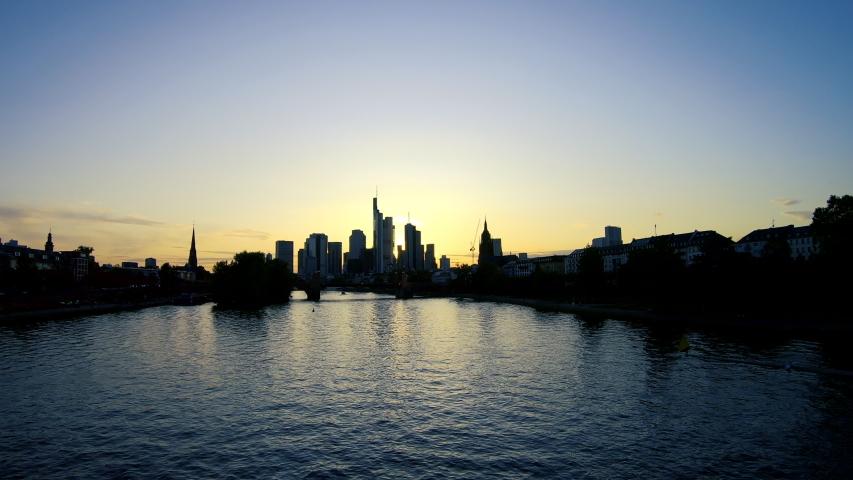 Frankfurt am Main, Germany - August 14, 2019: Hyperlapse at sunset of the Frankfurt skyline and river Main | Shutterstock HD Video #1056772850