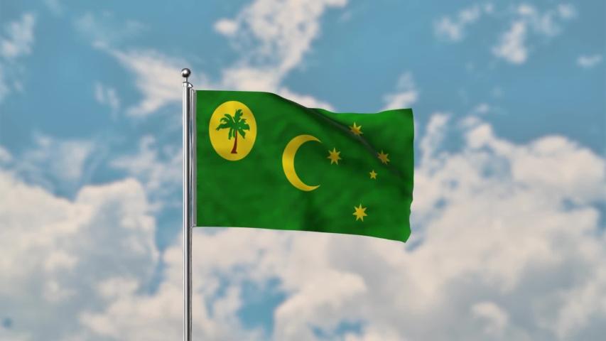 Cocos (Keeling) Islands flag waving in the blue sky realistic 4k Video.
