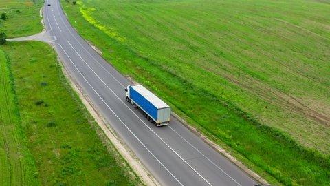 Highway trucks cars field road transportation logistics