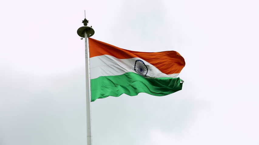 INDIA FLAG FLYING HIGH WITH PRIDE, india flag fluttering, india independence day and republic day of india, tilt up shot