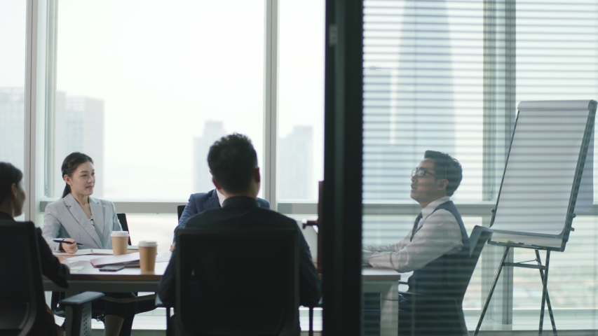 Group of corporate executives meeting in conference room of modern corporation | Shutterstock HD Video #1056845627