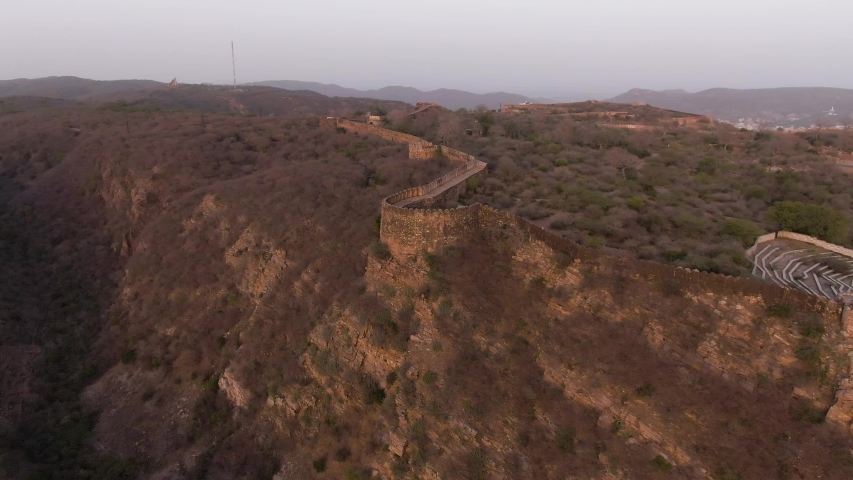 Jaipur pink city aerial panoramic. Sunset 4k footage of beautiful skyline in historic city. Birds eye view of scenic landscapes from nahargarh fort in Jaipur, Rajasthan, India
