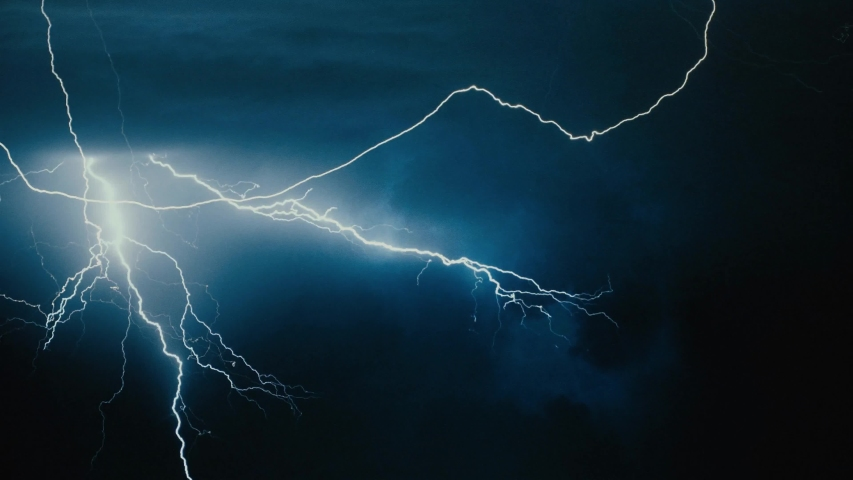 Spectacular thunderstorm lightning strikes dark night | Shutterstock HD Video #1056857360