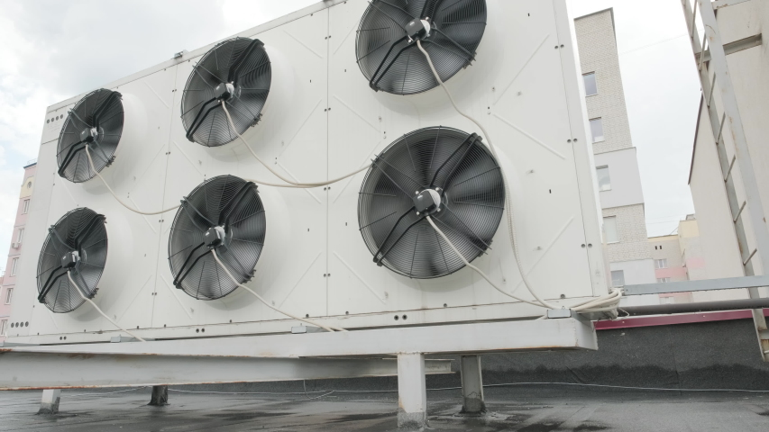 Heating Ventilating and Air Conditioning Units on the Roof | Shutterstock HD Video #1056867173