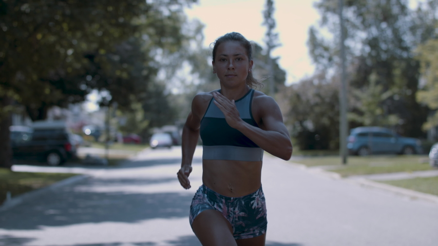 Running as fast as you can. Confident and powerful woman running with determination and focus.Shot in 4k
