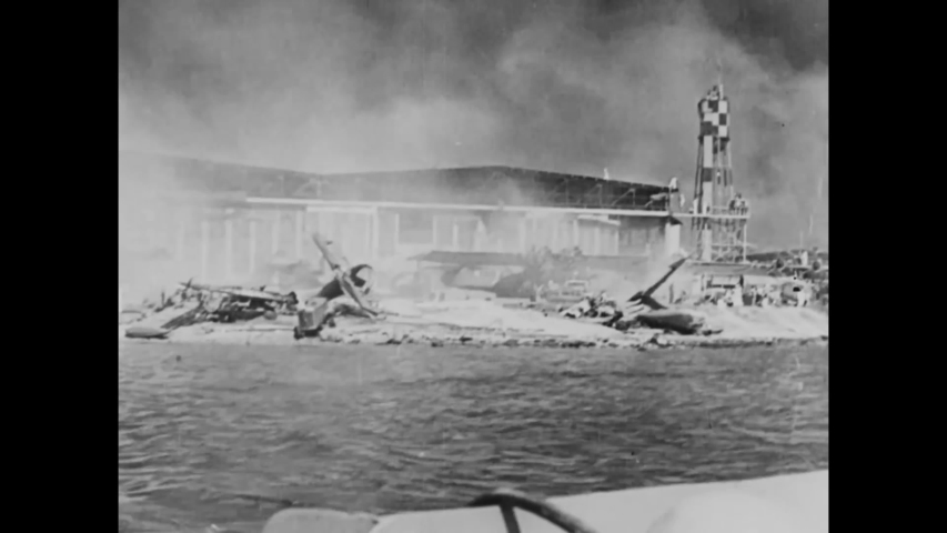 CIRCA 1941 - In this documentary directed by Frank Capra, burning wreckage of the Pearl Harbor attacks and wounded American sailors are shown.
