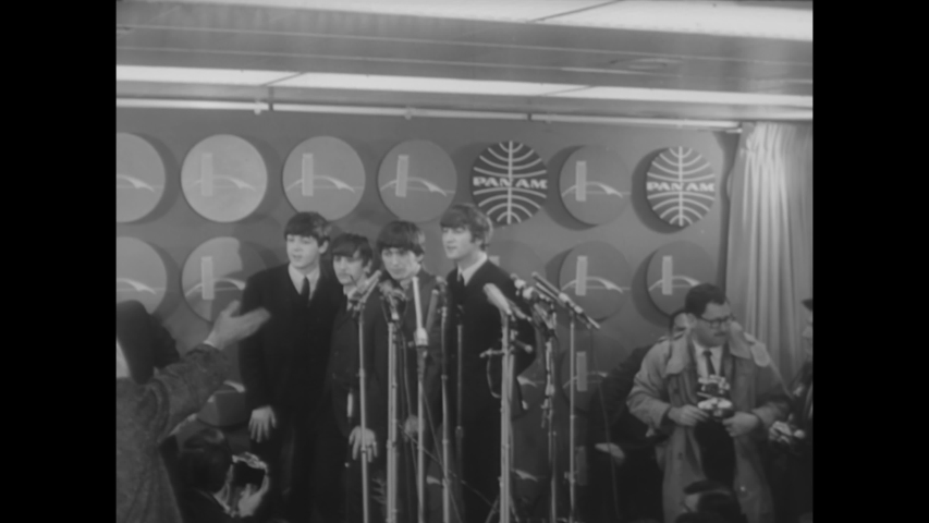 CIRCA 1964 - The Beatles hold a press conference in New York while fans scream outside, then visit Central Park.