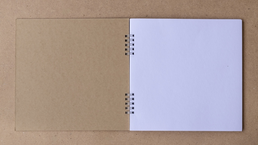 4K UHD Stop motion book animation open white blank page for writing on wooden background. Royalty-Free Stock Footage #1056889373