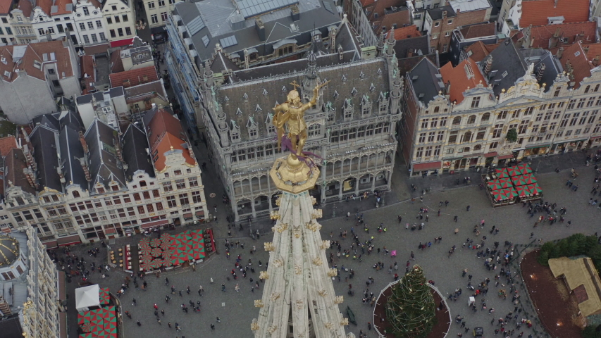 Brussels Belgium Aerial  Birdseye view flying around Saint Michel statue in Grand Place - December 2019