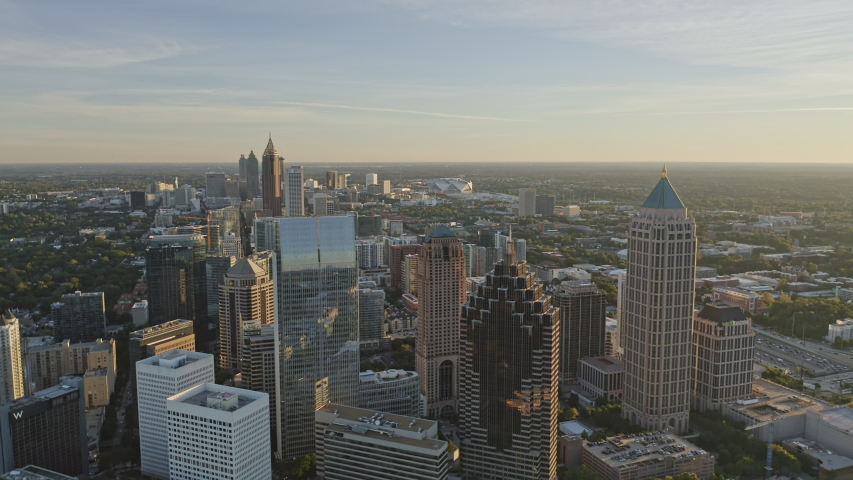 Atlanta Aerial  Traversing at an angle from Midtown through Old Fourth Ward district with Downtown skyline cityscape - December 2018