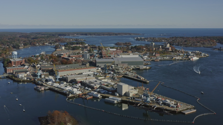Portsmouth New Hampshire Aerial Panning above naval shipyard, Maine side - November 2019
