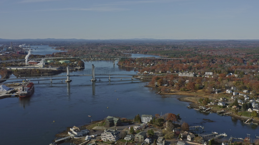Portsmouth New Hampshire Aerial  Short panning bridge and river cityscape - November 2019