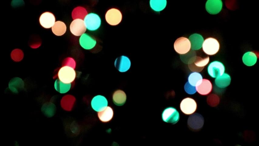 Blurred light highlights of new year's holiday illumination garlands | Shutterstock HD Video #1056894650