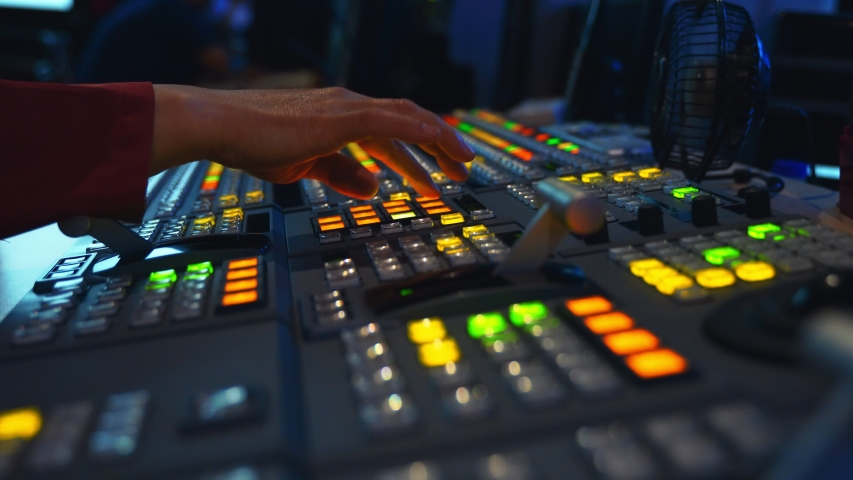 Broadcast Tv Studio Production - Vision Switcher Studio Director broadcast video mixer operation - Close-up of hand. Hands of a cinematographer who worked on the vision mixer, switch the TV panel. | Shutterstock HD Video #1056908216