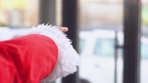 Santa Claus at a car dealership chooses a gift car