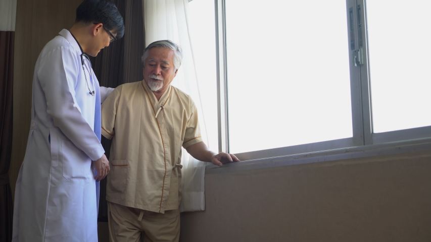 Young asian doctor helping old man patient walking in hospital | Shutterstock HD Video #1056927833
