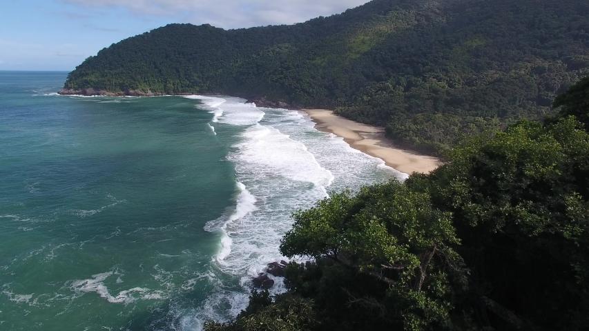 Aerial view of Brava de Boiçucanga Beach, atlantic forest area, Serra do Mar State Park Royalty-Free Stock Footage #1056930269