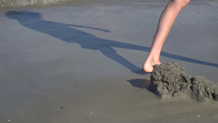 Young woman walking on the seaside in slow motion. | Shutterstock HD Video #1056930305