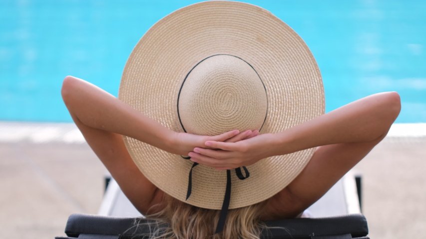 Traveler tourist bikini woman in hat relaxing vacation happy holiday at luxury hotel tropical resort swimming pool. enjoying summer spa travel tourism beach ocean lifestyle outdoors slow-mo, 4 K