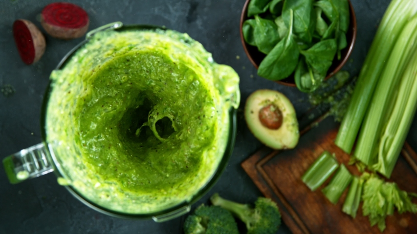 Green fresh smoothie blended in blender, top view. Healthy eating concept. Super slow motion filmed on high speed cinematic camera. | Shutterstock HD Video #1056951644