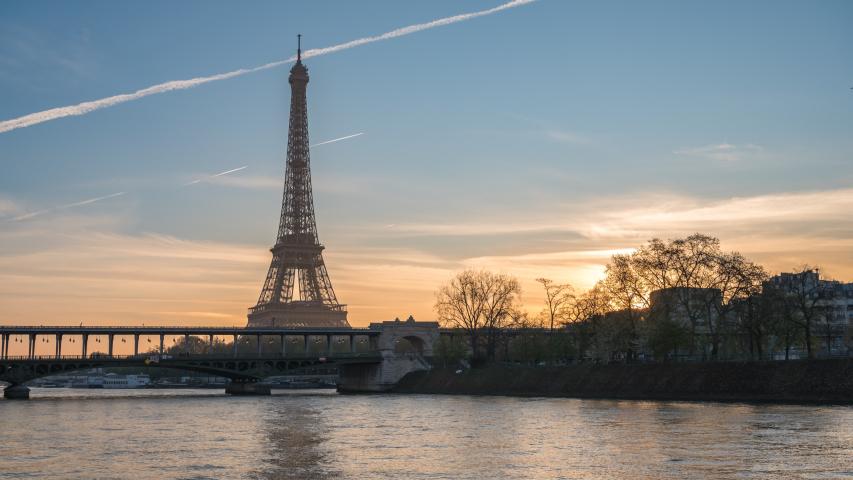 Paris France time lapse 4K, city skyline sunrise timelapse at Eiffel Tower and Seine River Bir-Hakeim Bridge