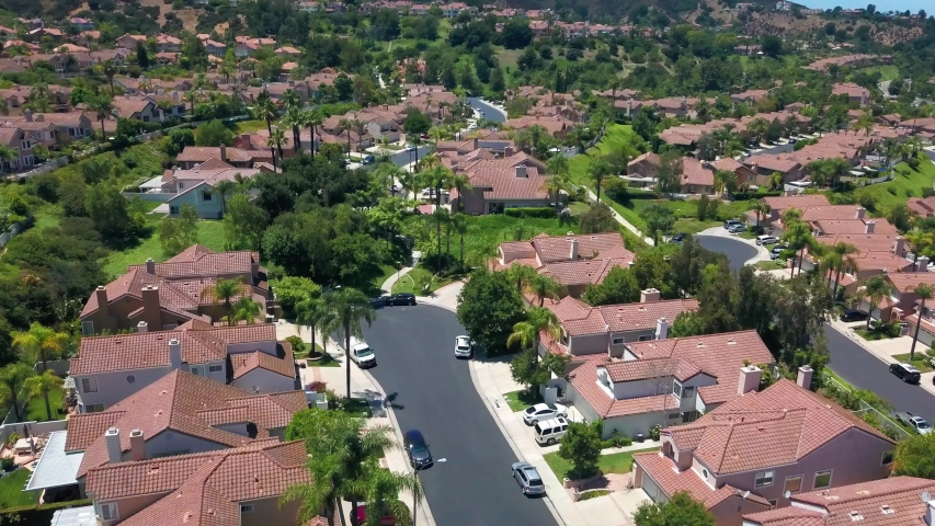 Aerial orbital shot above an upscale gated suburban community in Southern California. 4K | Shutterstock HD Video #1056980060