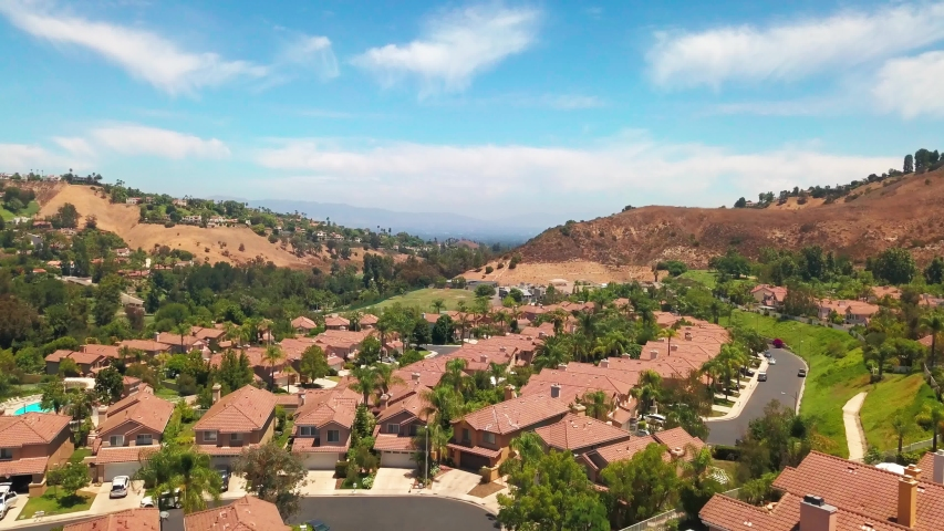 Aerial rising shot of an upscale gated suburban community in Southern California. 4K | Shutterstock HD Video #1056980153