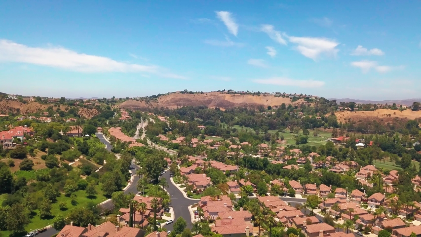 Wide aerial shot of an upscale gated suburban community in Southern California. 4K | Shutterstock HD Video #1056980156