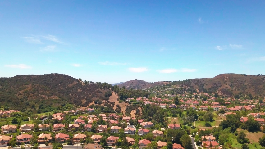 Aerial descending shot of an upscale gated suburban community in Southern California. 4K | Shutterstock HD Video #1056980159