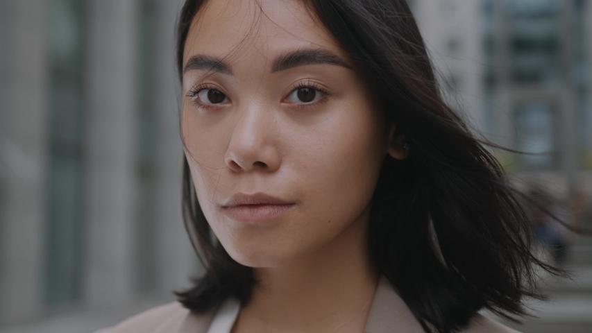 Close-up portrait of nice-looking asian multi-race beautiful businessperson elegant young woman looking into camera. Career people. Fashion, beauty. Female portraits. | Shutterstock HD Video #1056986567