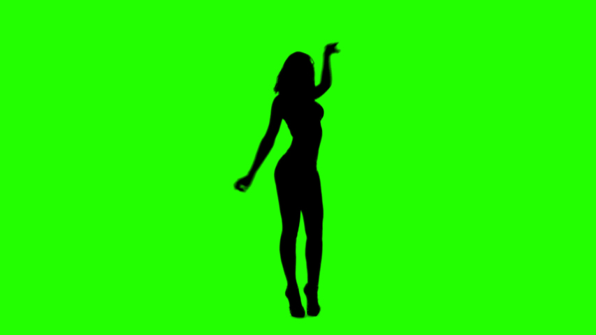 Beautiful Slim Girl Dancing Slowly On a Green Background. Sexual Female Silhouette with Alpha Channel.